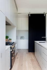 barn door for kitchen cabinets 10 exles of barn doors in contemporary kitchens bedrooms