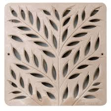 12 in plastic botanical design square decorative grate in sand