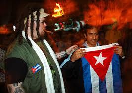 along the malecón a tattooed gringo shares his cuban flag