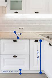 what is standard height for kitchen cabinets kitchen cabinet height guide how high should they be mad