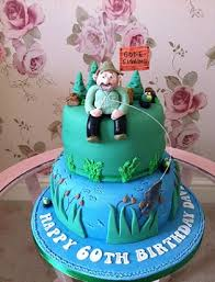 easy fishing cake idea tier cake with a fishing theme with hand