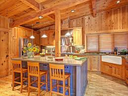 design of small rustic kitchen with stone wall and oak kitchen