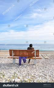 woman sitting on wood bench back stock photo 90439531 shutterstock
