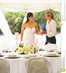chic bridal wedding planner with wedding planner in marquee