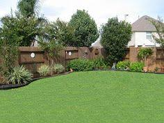 a backyard backyard landscaping along fence gardening outdoors