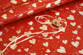 shiny wrapping paper wrapping paper with shiny hearts and ribbon with a flower