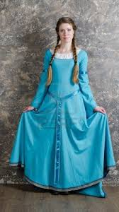 10921685 pretty young woman in historical medieval blue dress