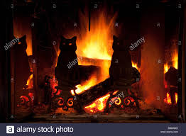 brilliant yellow flames behind silhouetted black cat irons in