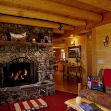 of a log home or cabin this winter real decorations stone of a log home or cabin this winter real decorations stone fireplace at living room with