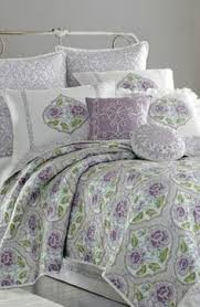 Dena Home Bedding Appliquéd Ruffles Ripple Over A Mixed Print Comforter Lit With