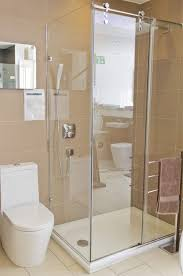 bathroom beautiful unique design using white ceramic full size bathroom white toilet clear glass door ideas brown tiles small with