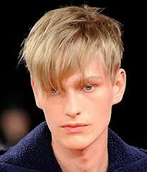 chic men haircut with long layered bangs with very short hair in