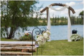 wedding arch log lakeside wedding big bar lake bc novak photography