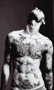 black and white photo ride the snake half body tattoo tattoomagz
