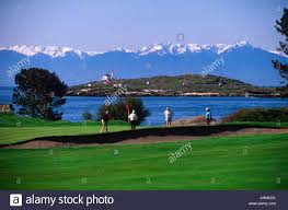 victoria golf course with the olympic peninsula mountains and