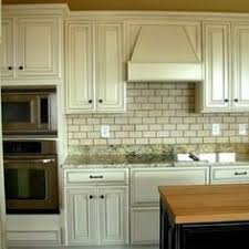 White Kitchen Cabinets With Glaze by Heritage White Cabinets With Dark Glaze These Light Cabinets Are