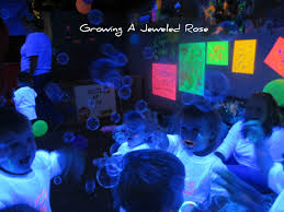 glow in the dark halloween party ideas black light themed group sensory play growing a jeweled rose