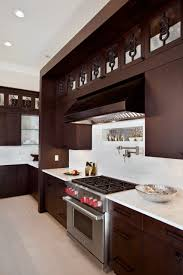 Dark Kitchen Cabinets With Backsplash by House Design Dark Kitchen Cabinets With Copper Range Hoods And