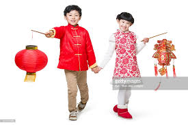 happy children celebrating new year with traditional