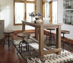 5 piece counter table set with industrial style adjustable swivel