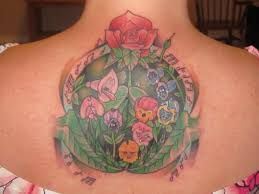 this was my first tattoo all in a golden afternoon flower scene