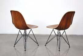 select modern pair of eames herman miller palisander and black