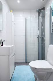 apartment bathroom designs apartments steel shower white wall small mirrror white cabinet