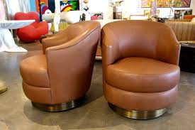 Orange Leather Swivel Chair A Rudin Leather Swivel Chairs With Brass Base Ordered By Steve