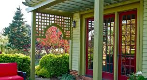 metal lattice panels spaces with brick covered porch green