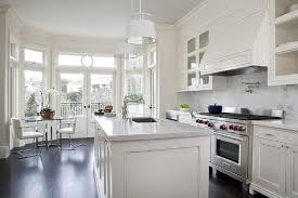 endearing white kitchen cabinets with white marble countertops