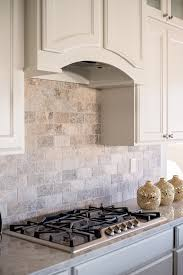 A Full Wall Subway Patterned Silver Travertine Backsplash Is - Travertine tile backsplash