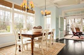 traditional dining room with transom window by garrison hullinger