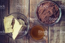 cocoa butter cocoa powder and honey on grunge wooden background