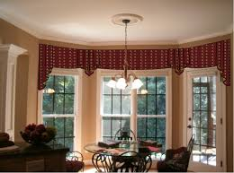 interior bay window treatment ideas with round glass table black