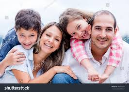 portrait happy loving family smiling outdoors stock photo