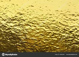 shiny wrapping paper gold foil leaf shiny wrapping paper texture background for wall