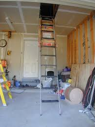 panofish installing a folding attic ladder in the garage
