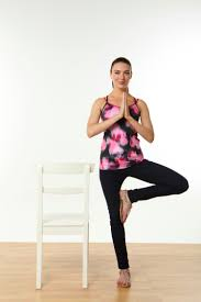 10 yoga stretches to do at your desk more com