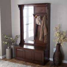 classic wooden coat rack with mirror and decoration in the room