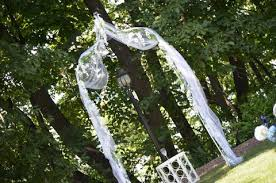 wedding arches decorated with tulle tyricka s the simple arbor and chivari chairs fit in
