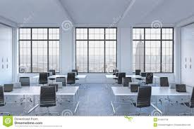 workplaces in a bright modern open space loft office white tables