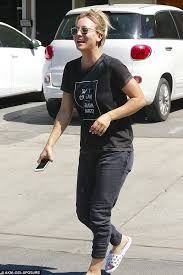 kaley cuoco displays her keep fit mantra on her shirt as she