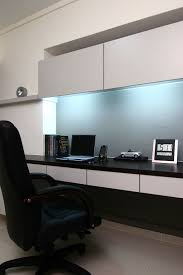 modern home office and study room design idea with long wall