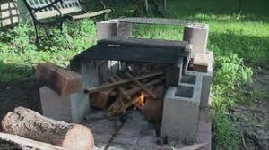 Starting A Fire Pit - starting fire in fire pit made of building blocks 5 stock video