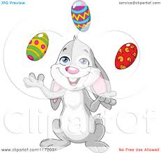 cartoon of a happy easter bunny juggling eggs royalty free