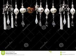 silver and white tree ornaments on black stock image