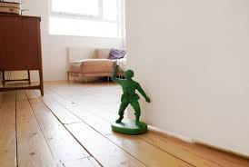 green army man door stop the green head