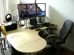 ikea galant desk with 3 portrait monitor eyefinity setup and black chair