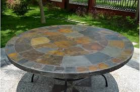 slate outdoor dining table 125 160cm round slate patio dining table tiled mosaic oceane