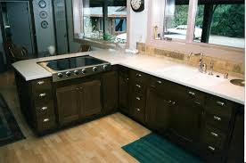 l shaped dark stained oak wood kitchen cabinet which mixed with